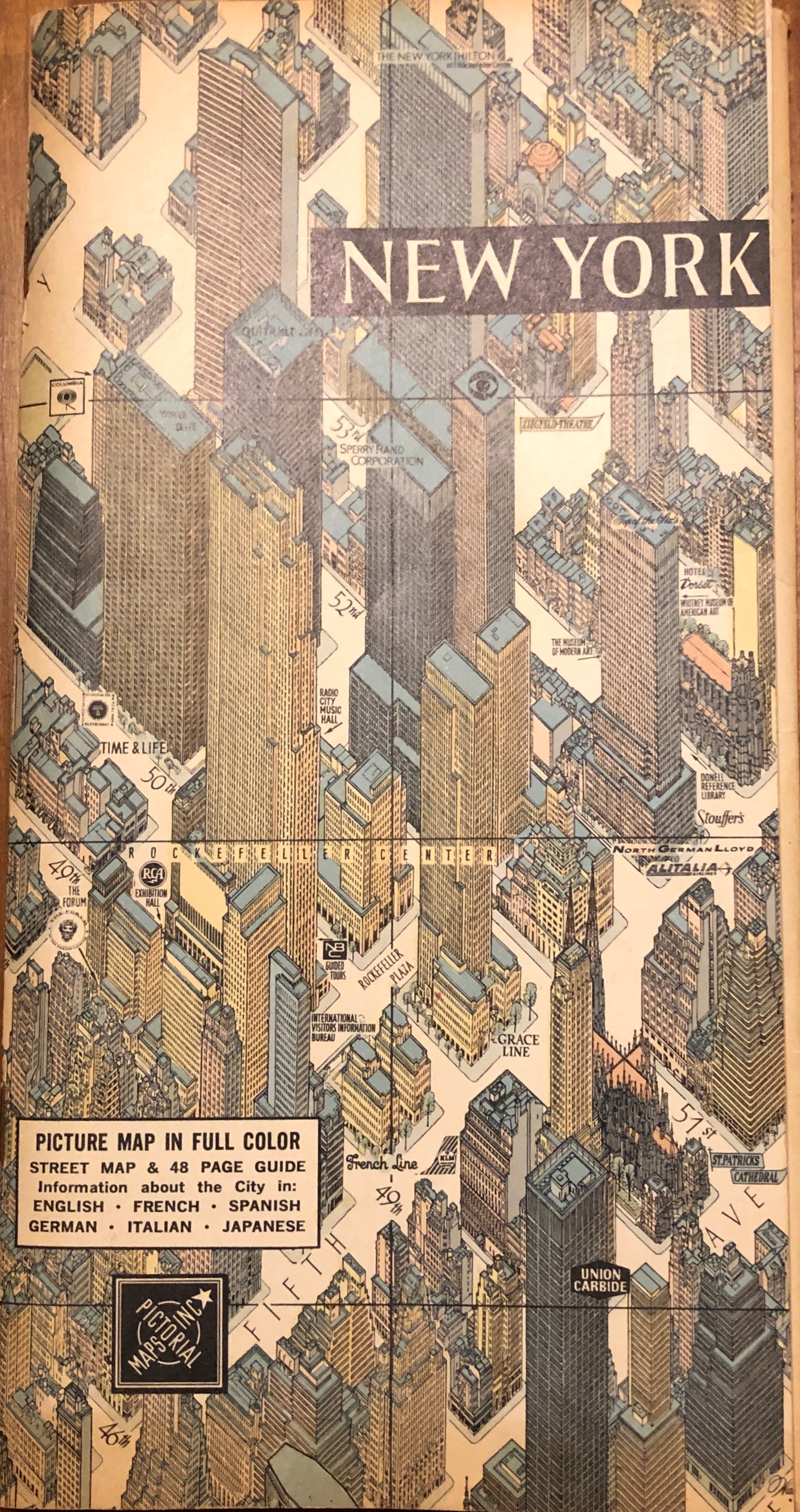 New York Pictorial Map in Full Color. Two-sided Street Map and 48-page Guide. Birds-eye View from Hudson River to East River, Little West Village to Central Park. Full page map of Richmond, Staten Island on Verso. Created by Hermann Bollmann, Artist, for Pictorial Maps, Inc., 99 Warren Street, New York City.